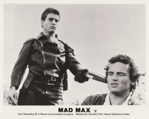 """Mel Gibson as Max alongside Tim Burns as """"Johnny the Boy"""" in Mad Max (1979)"""