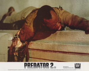 Danny Glover is grabbed by The Predator!