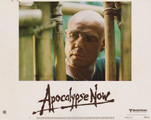 A lobby card featuring Marlon Brando in Apocalypse Now (1979)